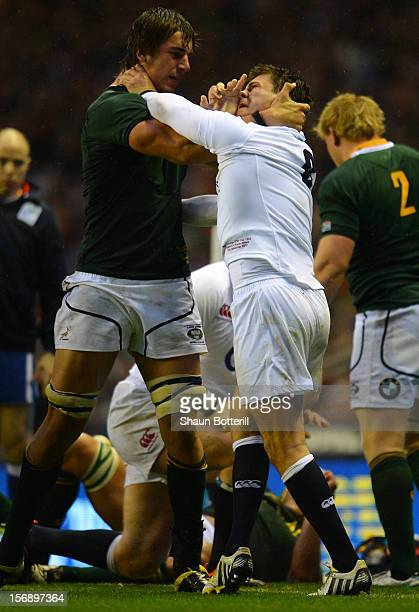Ben Youngs clashes with Eben Etzebeth of South Africa during the QBE International match between England and South Africa at Twickenham Stadium on...