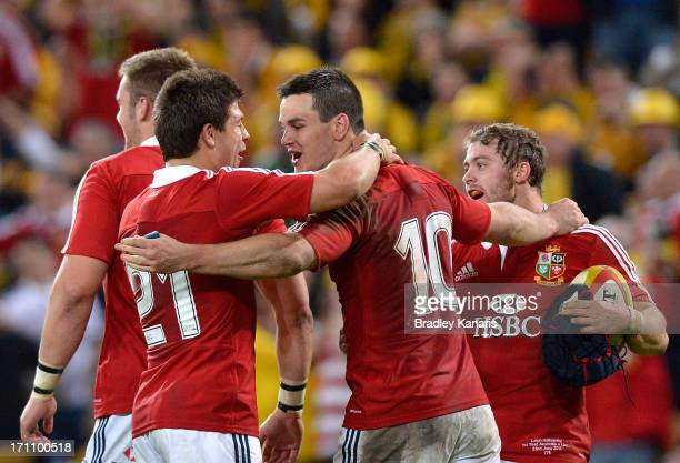Ben Youngs Jonathon Sexton and Leigh Halfpenny celebrate victory after the First Test match between the Australian Wallabies and the British Irish...
