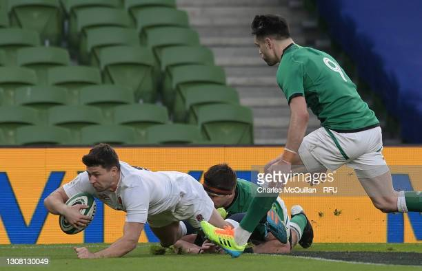 Ben Youngs of England beats CJ Stander of Ireland to go over to score their side's first try during the Guinness Six Nations match between Ireland...