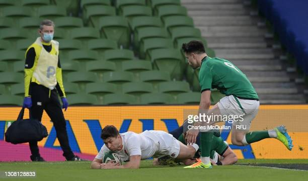 Ben Youngs of England beats Conor Murray of Ireland to go over and score their side's first try during the Guinness Six Nations match between Ireland...