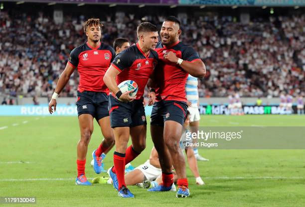 Ben Youngs of England celebrates scoring his side's third try with his team mate Manu Tuilagi during the Rugby World Cup 2019 Group C game between...