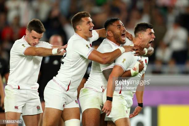 Ben Youngs of England celebrates with Henry Slade and Manu Tuilagi of England after scoring a try prior to being disallowed during the Rugby World...