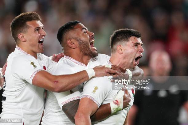 Ben Youngs of England celebrates with team mates Manu Tuilagi and Henry Slade after scoring his sides second try, which was later disallowed during...