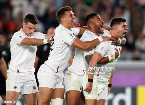 Ben Youngs of England celebrates with teammates Manu Tuilagi Henry Slade and George Ford after scoring a disallowed try during the Rugby World Cup...