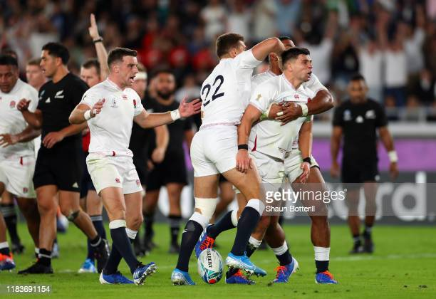 Ben Youngs of England celebrates with team-mates Manu Tuilagi, Henry Slade and George Ford after scoring a disallowed try during the Rugby World Cup...