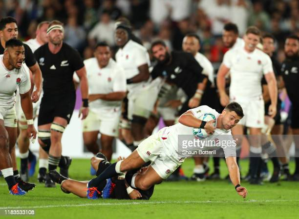 Ben Youngs of England scores a try as he beats the tackle of Aaron Smith of New Zealand before being disallowed during the Rugby World Cup 2019...