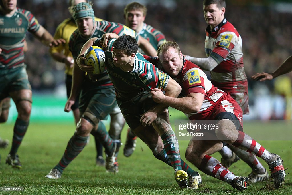 Ben Youngs of Leicester is tackled by Dario Christolini during the Aviva Premiership match between Leicester Tigers and Gloucester at Welford Road on December 29, 2012 in Leicester, England.
