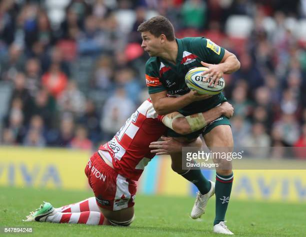 Ben Youngs of Leicester is tackled by Lewis Ludlow during the Aviva Premiership match between Leicester Tigers and Gloucester Rugby at Welford Road...