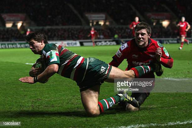 Ben Youngs of Leicester scores his sides second try despite the attempted tackle from Rhys Priestland of Scarlets during the Heineken Cup Pool Five...