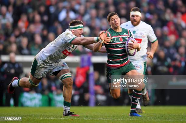 Ben Youngs of Leicester Tigers breaks from Julien Delannoy of Pau during the European Rugby Challenge Cup Round 1 match between Leicester Tigers and...