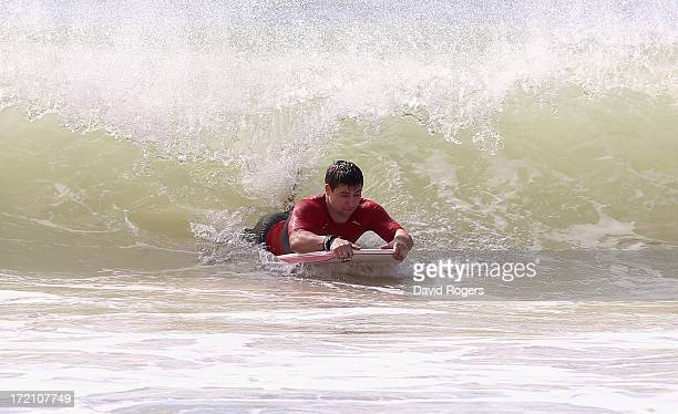 Ben Youngs of the British and Irish Lions rides a wave during surfing on July 2 2013 in Noosa Australia