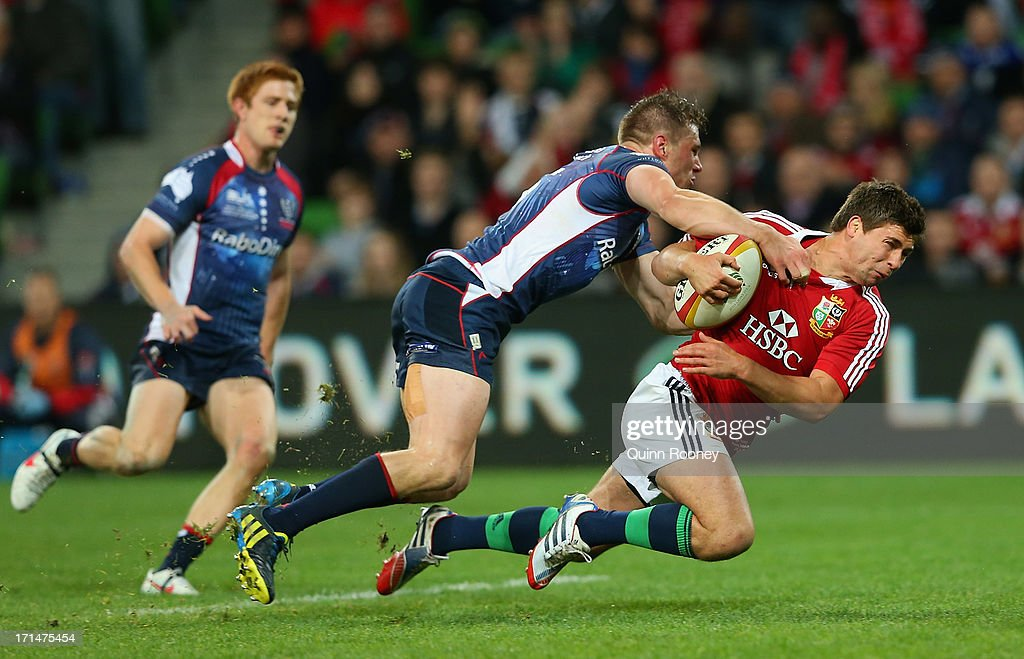 Ben Youngs of the Lions is tackled by Jason Woodward of the Rebels during the International Tour Match between the Melbourne Rebels and the British & Irish Lions at AAMI Park on June 25, 2013 in Melbourne, Australia.