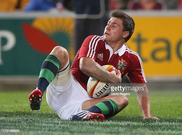 Ben Youngs of the Lions turns after scoring a try during the match between the Queensland Reds and the British Irish Lions at Suncorp Stadium on June...