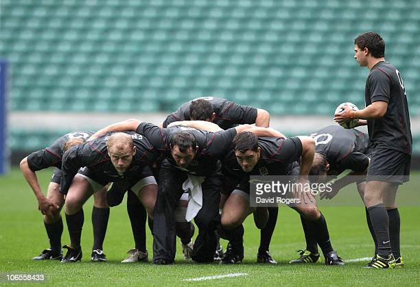 Ben Youngs prepares to pass the bal to the front row Dan Cole Steve Thompson and Andrew Sheridan during the training session held at Twickenham...