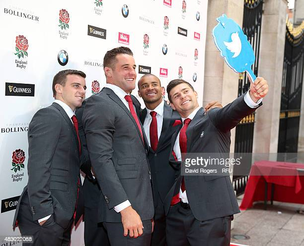 Ben Youngs takes a selfie with the Twitter mirror with fellow players George Ford; Calum Clark and Jonathan Joseph prior to the Carry Them Home...