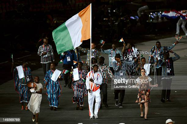 Ben Youssef Meite of the Cote d'Ivoire Olympic athletics team carries his country's flag during the Opening Ceremony of the London 2012 Olympic Games...