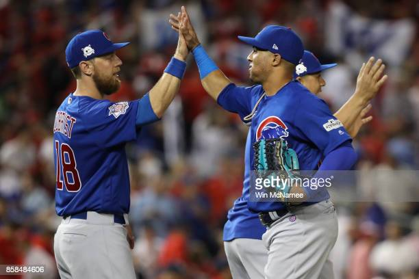 Ben Zobrist of the Chicago Cubs and Leonys Martin of the Chicago Cubs after defeating the Washington Nationals in game one of the National League...