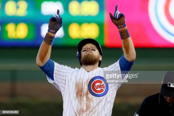 Ben Zobrist of the Chicago Cubs celebrates after hitting a double in the seventh inning against the Washington Nationals during game three of the...