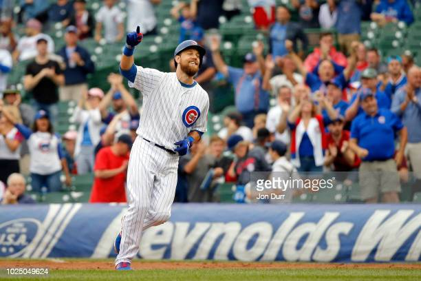Ben Zobrist of the Chicago Cubs celebrates after hitting a walkoff RBI single against the New York Mets during the 11th inning at Wrigley Field on...