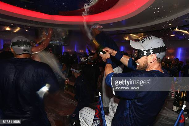 Ben Zobrist of the Chicago Cubs celebrates in the clubhouse after defeating the Los Angeles Dodgers 50 in game six of the National League...