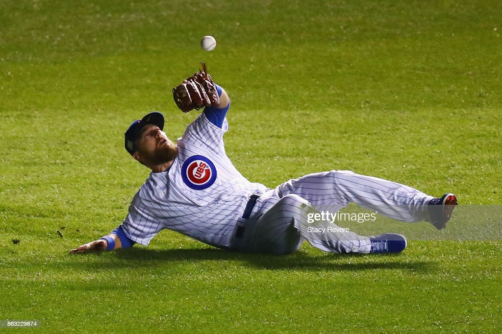 Ben Zobrist #18 of the Chicago Cubs fails to catch a fly ball in the fourth inning against the Los Angeles Dodgers during game five of the National League Championship Series at Wrigley Field on October 19, 2017 in Chicago, Illinois.