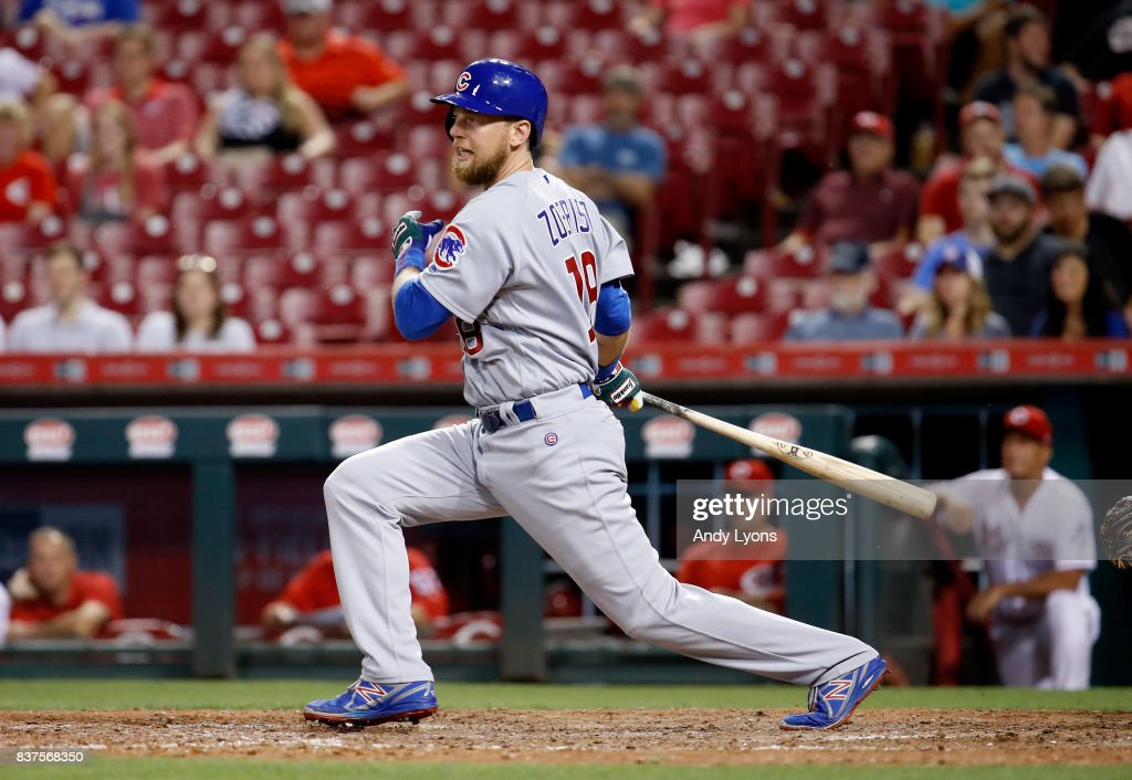 Ben Zobrist #18 of the Chicago Cubs hits a run scoring ground out in the 8th inning against the Cincinnati Reds at Great American Ball Park on August 22, 2017 in Cincinnati, Ohio.