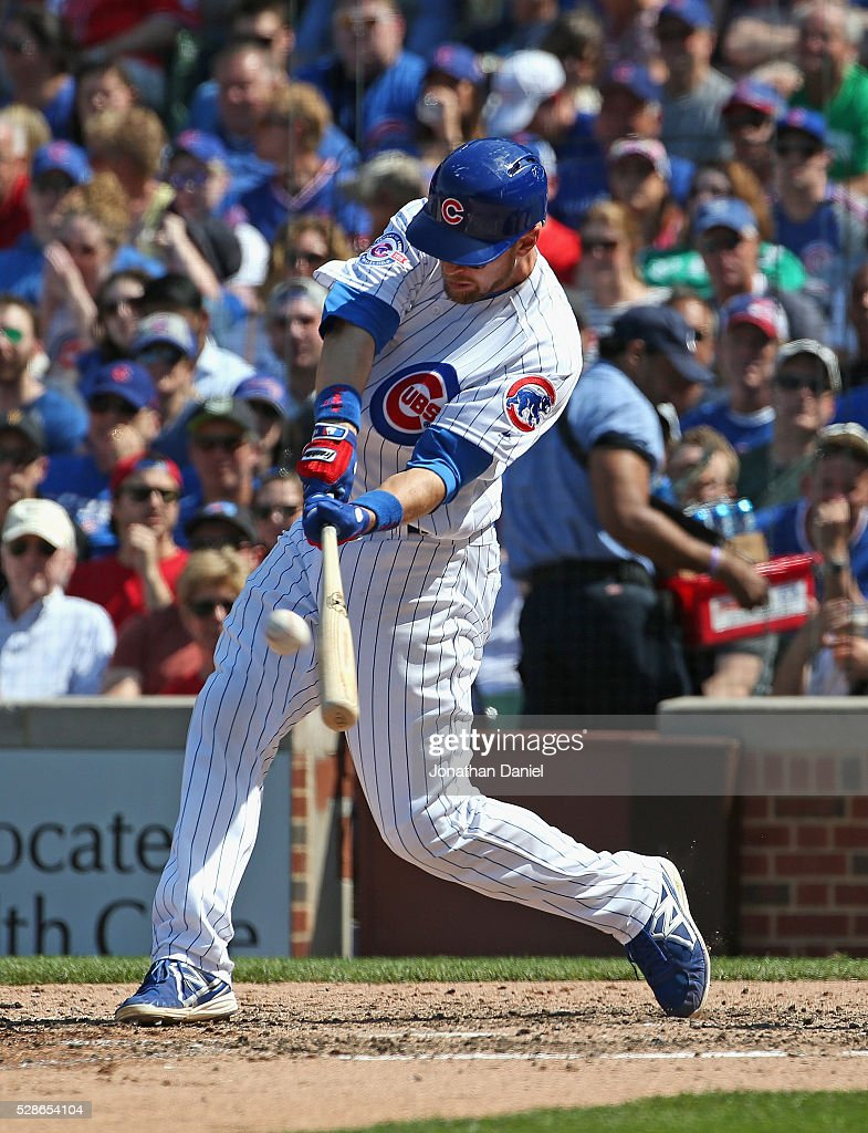 Ben Zobrist #18 of the Chicago Cubs hits a three-run home run in the 5th inning against the Washington Nationals at Wrigley Field on May 6, 2016 in Chicago, Illinois.