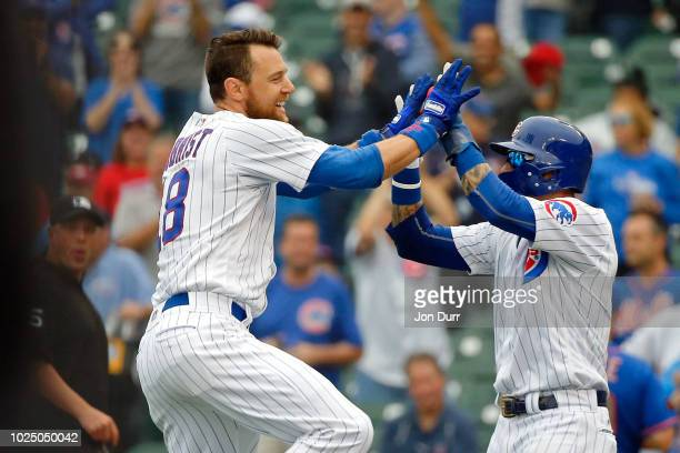 Ben Zobrist of the Chicago Cubs is celebrates with Javier Baez after hitting a walkoff RBI single against the New York Mets during the eleventh...
