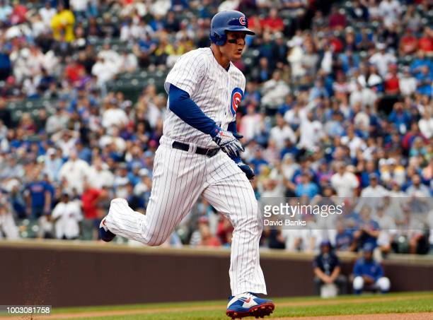 Ben Zobrist of the Chicago Cubs is greeted after scoring during the fifth inning against the St Louis Cardinals during game one of a doubleheader on...
