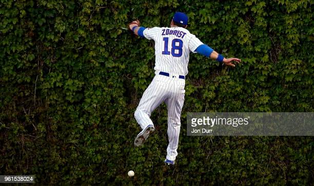 Ben Zobrist of the Chicago Cubs is unable to make a catch on a double hit by Francisco Lindor of the Cleveland Indians during the fifth inning at...