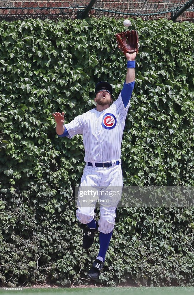 Ben Zobrist #18 of the Chicago Cubs leaps tomake a catch against the San Francisco Giants at Wrigley Field on May 25, 2018 in Chicago, Illinois. The Cubs defeated the Giants 6-2.