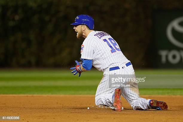 Ben Zobrist of the Chicago Cubs reacts after hitting a double in the eighth inning against the Los Angeles Dodgers during game one of the National...