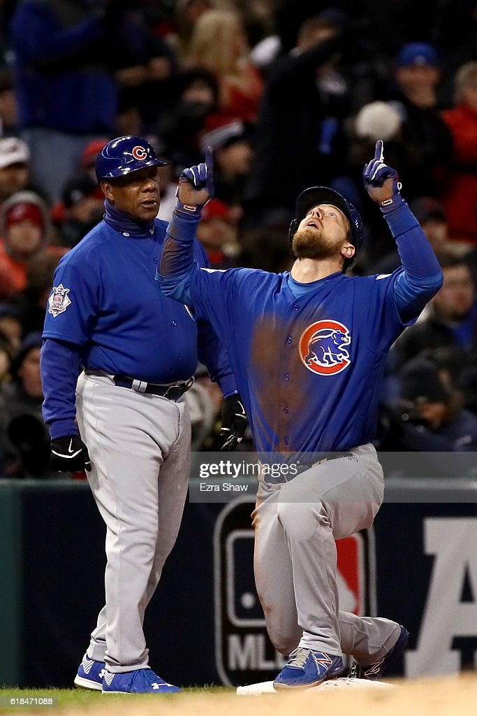 Ben Zobrist #18 of the Chicago Cubs reacts at third base after hitting an RBI triple to score Anthony Rizzo #44 (not pictured) during the fifth inning against the Cleveland Indians in Game Two of the 2016 World Series at Progressive Field on October 26, 2016 in Cleveland, Ohio.