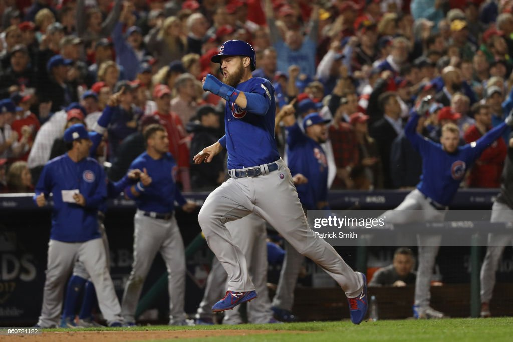 Ben Zobrist #18 of the Chicago Cubs runs into home on a double hit by Addison Russell #27 of the Chicago Cubs against the Washington Nationals during the fifth inning in game five of the National League Division Series at Nationals Park on October 12, 2017 in Washington, DC.