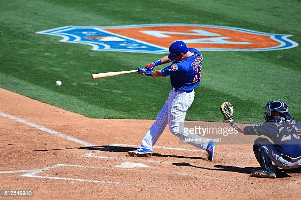 Ben Zobrist of the Chicago Cubs singles in the sixth inning against the Milwaukee Brewers during the spring training game at Sloan Park on March 25...