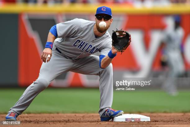 Ben Zobrist of the Chicago Cubs takes the throw at second base for a force out in the second inning against the Cincinnati Reds at Great American...