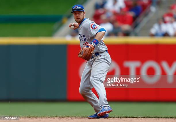 Ben Zobrist of the Chicago Cubs throws the ball to first base during the game against the Cincinnati Reds at Great American Ball Park on April 23...