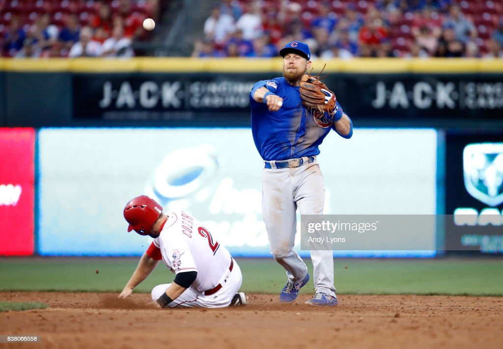 Ben Zobrist #18 of the Chicago Cubs throws the ball to first base to complete a double play in the third inning against the Cincinnati Reds at Great American Ball Park on August 23, 2017 in Cincinnati, Ohio.