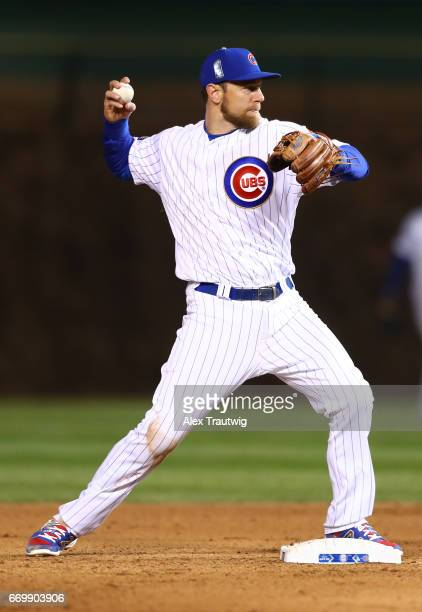 Ben Zobrist of the Chicago Cubs throws to first base for an out during the game against the Los Angeles Dodgers at Wrigley Field on Wednesday April...
