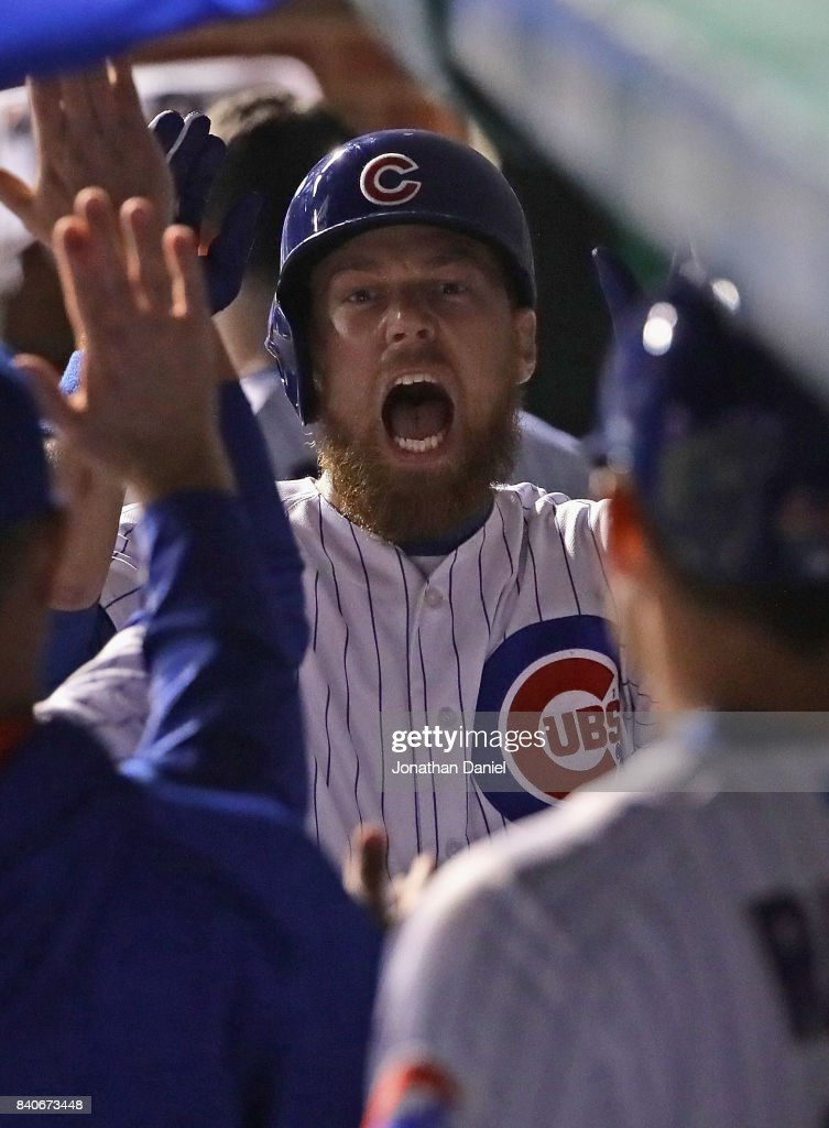 Ben Zobrist #18 of the Chicago Cubs yells as he's greeted in the dugout after hitting a solo home run in the 6th inning against the Pittsburgh Pirates at Wrigley Field on August 29, 2017 in Chicago, Illinois.
