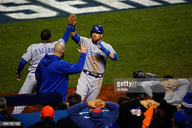Ben Zobrist of the Kansas City Royals celebrates after scoring in the eighth inning with Alcides Escobar against the New York Mets during Game Four...