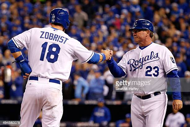 Ben Zobrist of the Kansas City Royals fist bumps Mike Jirschele of the Kansas City Royals in the sixth inning against the New York Mets during Game...