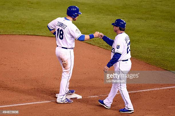 Ben Zobrist of the Kansas City Royals fist pumps third base coach Mike Jirschele during Game 1 of the 2015 World Series against the New York Mets at...