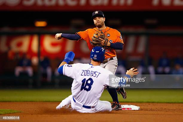 Ben Zobrist of the Kansas City Royals is out at second base as Jose Altuve of the Houston Astros throws to first base to complete the double play in...