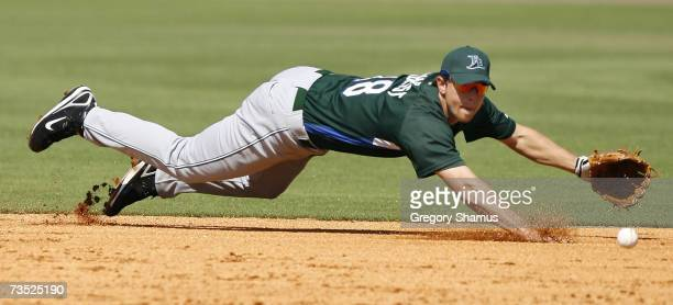 Ben Zobrist of the Tampa Bay Devil Raysmakes a diving stop but could not get the runner at first during a Spring Traing game against the Pittsburgh...