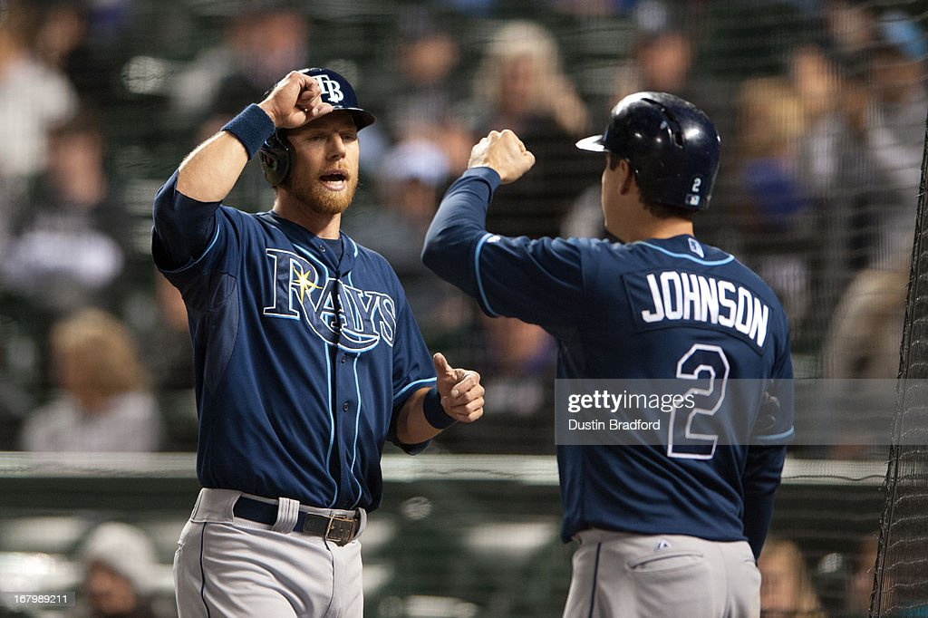 Ben Zobrist #18 of the Tampa Bay Rays celebrates a 10th-inning go-ahead run with Kelly Johnson #2 during a game against the Colorado Rockies at Coors Field on May 3, 2013 in Denver, Colorado. The Rays beat the Rockies 7-4 in ten innings.