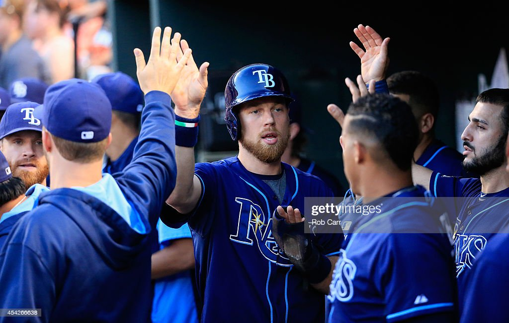 Ben Zobrist #18 of the Tampa Bay Rays celebrates in the dugout after scoring a run in the first inning against the Baltimore Orioles at Oriole Park at Camden Yards on August 27, 2014 in Baltimore, Maryland.