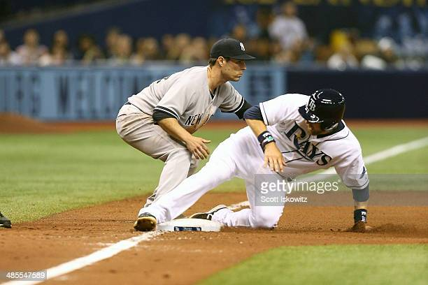 Ben Zobrist of the Tampa Bay Rays slides safely into 3rd base past Scott Sizemore of the New York Yankees during the 8th inning at Tropicana Field on...