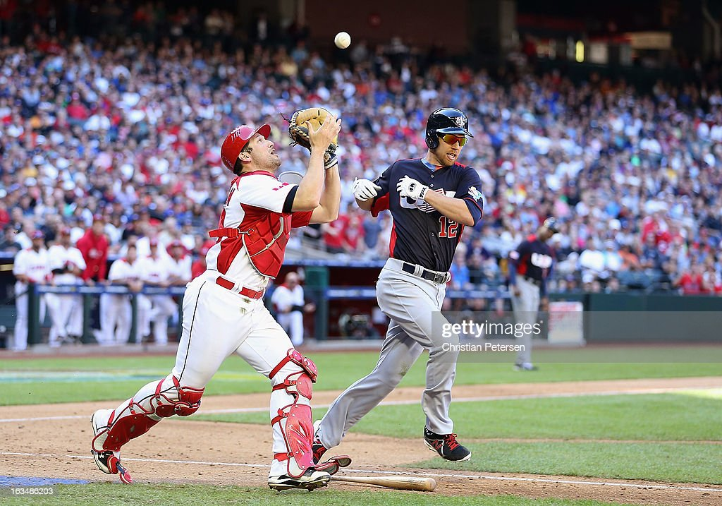 Ben Zobrist #12 of USA pops out to catcher Chris Robinson #30 of Canada during the eighth inning of the World Baseball Classic First Round Group D game at Chase Field on March 10, 2013 in Phoenix, Arizona. USA defeated Canada 9-4.