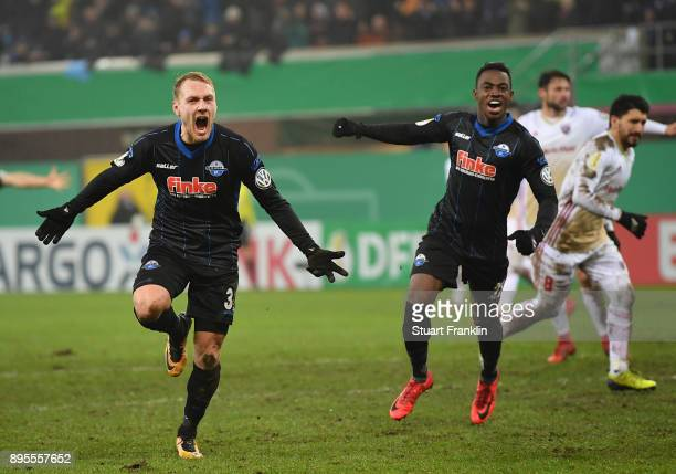 Ben Zolinski of Paderborn celebrates scoring his goal with Christopher AntwiAdjej during the DFB Cup match between SC Paderborn and FC Ingolstadt at...
